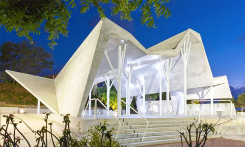 Ron Shenkins cemetery meeting space is a mountain like concrete canopy in Israel 889x535